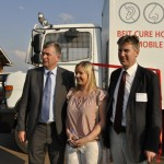 Irish ambassador, Tony Cotter (left), Jennifer Coyne of Gorta (centre) & Dr. Kieran O'Driscoll of ENT for Zambia pose in front of the new ENT mobile clinic