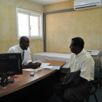 CURE Zambia's audiologist, Alfred Mwamba chats with a patient