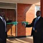 Peter Kyalo and Dr. Siakanthu about to cut the ribbon
