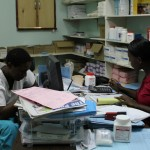 Rutendo (left) and Inonge take inventory in the pharmacy