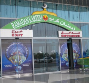 The local grocery store entrance is decorated with &quot;Ramadan Kareem&quot; which is a seasonal greeting.