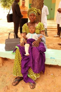mother and child outside clubfoot clinic in Niger