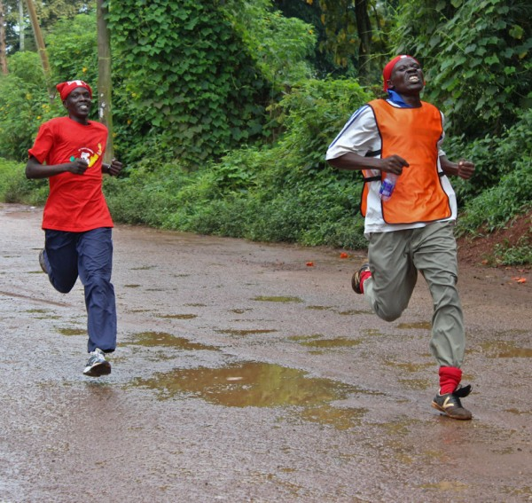 Moses Nyote (red), social worker, gains ground on the leader in CURE Uganda's inaugural 5k.
